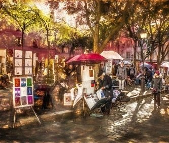 place du tertre a montmartre, particolare di un pittore con i suoi dipinti.